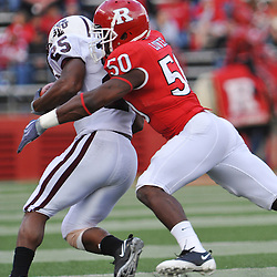 Oct 10, 2009; Piscataway, NJ, USA; Rutgers linebacker Antonio Lowery (50) wraps up Texas Southern running back Martin Gilbert (25) during first half NCAA college football action between Rutgers and Texas Southern at Rutgers Stadium.