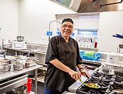 Working senior man kitchen.