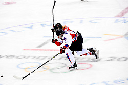 PYEONGCHANG, Feb. 10, 2018  Kim Heewon (front) of the unified team of the Democratic People's Republic of Korea (DPRK) and South Korea vies for the puck during their preliminary match of women's ice hockey against Switerland at the Pyeongchang 2018 Winter Olympic Games at the Kwandong Hockey Centre in Gangneung, South Korea, on Feb. 10, 2018. (Credit Image: © Wang Song/Xinhua via ZUMA Wire)