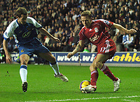 Photo: Paul Greenwood.<br />Wigan Athletic v Liverpool. The Barclays Premiership. 02/12/2006. Wigan's David Wright, left, challenges Liverpool's Craig Bellamy in the area.