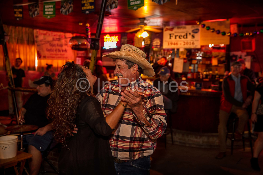 Cajun dancing in Freds Lounge on 28th February 2020 in Mamou, Louisiana, United States. Freds Lounge rarely advertises, yet the pub that is open only on Saturday mornings is known worldwide. The small town of Mamou is one of the last bastions of Cajun culture. On the outside, Freds place looks like any ordinary red brick beer joint. But promptly at 9:15 on Saturday mornings the music and dancing starts igniting a two-hour radio show transmitted throughout the area. Freds Lounge is unique in many ways. For one thing we serve alcohol at eight in the morning. Even for us Cajuns that unique, Libby, the owner, says with a laugh. She recommends starting with a spicy Bloody Mary. Thats our breakfast. We call it Freds omelet.