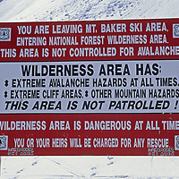 A sign warns skiers of the dangers of leaving Mount Baker Ski Area and entering Mount Baker Wilderness, where many seek abundant powder snow.