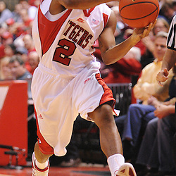 Feb 22, 2009; Piscataway, NJ, USA; Rutgers guard Anthony Farmer (2) passes into the paint to teammate Gregory Echenique (not pictured) during the second half of Rutgers' 74-56 loss to West Virginia at the Louis Brown Athletic Center.