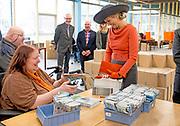 17-02-2015 STADSKANAAL - King Willem-Alexander and Queen Maxima of The Netherlands visit social employment agency Wedeka in Stadskanaal during an region visit to Veenkoloniën (peat colonies) of Groningen and Drenthe, 17 February 2015.  Photo: Robin Utrecht Streekbezoek van Koning Willem-Alexander en Koningin Máxima aan de Groningse en Drentse Veenkoloniën<br /> <br /> Visit of King Willem-Alexander and Queen Maxima at the Groningen and Drenthe peat.<br /> <br /> Op de foto / On the photo: Koning Maxima krijgt een rondleiding  bij het Werkvoorzieningsbedrijf Wedeka . Wedeka werkt met mensen die een afstand hebben tot de arbeidsmarkt. / Queen Maxima gets a tour at Wedeka. Wedeka works with people who have a distance to the labor market.