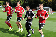 Gareth Bale of Wales (2nd l) during the Wales football team training session at the Vale Resort, Hensol Castle near Cardiff ,South Wales on Monday 31st August  2015. The team are preparing for their next EURO 2016 qualifying match away to Cyprus later this week.<br /> pic by Andrew Orchard, Andrew Orchard sports photography.