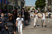 As the coronavirus restrictions continue and the government is about to announce an extension to the original freedom day planned for June, slowing the process of easing, more and more people begin to come to the city centre, seen here near the Bullring shopping centre on 15th June 2021 in Birmingham, United Kingdom. After months of lockdown, the first signs that life will start to get back to normal continue, with more people enjoying the company of others in public, while uncertainty continues for a projected further month, which is being dubbed The final push.