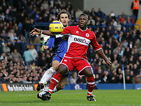 Photo: Lee Earle.<br /> Chelsea v Middlesbrough. The Barclays Premiership.<br /> 03/12/2005. Chelsea's Ricardo Carvalho (L) and Yakubu keep their eye on the ball.