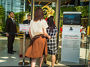 04 FEBRUARY 2015 - BANGKOK, THAILAND:  Shoppers go through security to get into Siam Paragon Mall in Bangkok. A small IED was detonated near the door of the mall over the weekend. After months of relative calm following the May 2014 coup, tensions are increasing in Bangkok. The military backed junta has threatened to crack down on anyone who opposes the government. Relations with the United States have deteriorated after Daniel Russel, the US Assistant Secretary of State for Asian and Pacific Affairs, said that normalization of relations between Thailand and the US would depend on the restoration of a credible democratically elected government in Thailand.   PHOTO BY JACK KURTZ