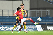 Swindon Twn Forward Tyler Smith (9) battles for possession with Oxford United midfielder Alex Gorrin (6) during the EFL Sky Bet League 1 match between Oxford United and Swindon Town at the Kassam Stadium, Oxford, England on 28 November 2020.
