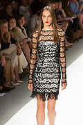 White and black print dress with beaded netting overlay.By Carlos Miele at the Spring 2013 Mercedes-Benz Fashion Week in New York.