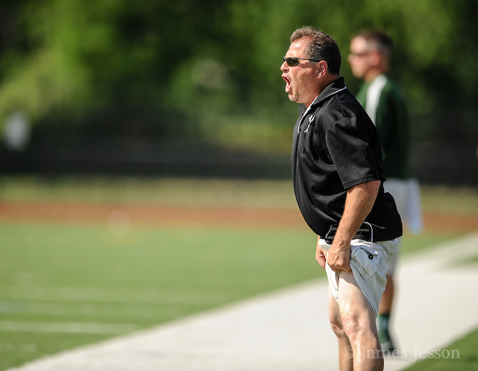 A Billerica Memorial High School assistant coach makes a point during the Division 1 North Championship game against Lincoln-Sudbury Regional High School at Connolly Memorial Stadium in Woburn, June 13, 2015. The Warriors beat the Indians, 12-8.   (Wicked Local Photo/James Jesson)