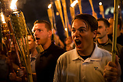 CHARLOTTESVILLE, USA - August 11: Neo Nazis, Alt-Right, and White Supremacists encircle and chant at counter protestors at the base of a statue of Thomas Jefferson after marching through the University of Virginia campus with torches in Charlottesville, Va., USA on August 11, 2017.