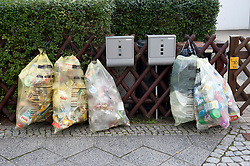 Domestic refuse sorted into recycling sacks outside house in Berlin Germany