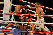 featherweight WBC world title eliminator.<br /> Lee Selby of Wales (r) v Romulo Koasicha of Mexico. 'The second coming'  boxing event at the Motorpoint Arena in Cardiff, South Wales on Sat 17th May 2014. <br /> pic by Andrew Orchard, Andrew Orchard sports photography.