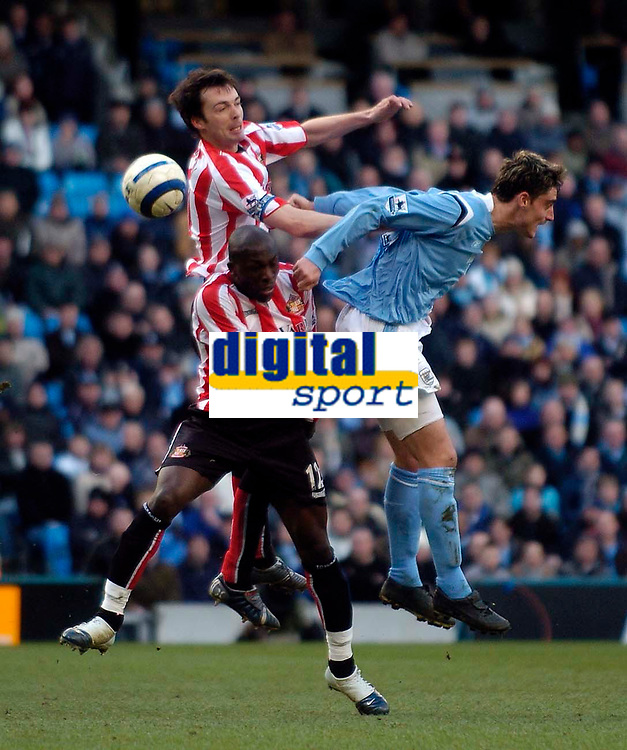 Photo: Jed Wee.<br /> Manchester City v Sunderland. The Barclays Premiership. 05/03/2006.<br /> <br /> Sunderland's Gary Breen (top) and Nyron Nosworthy combine to deny Manchester City's Albert Reira.