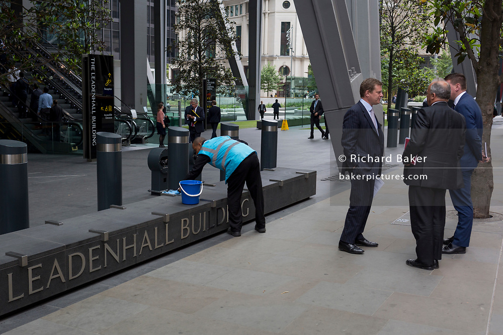 City businessmen and an employee of the Leadenhall Building, on 4th June 2018, in London, England.