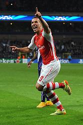 Arsenal's Lukas Podolski scores his winning goal in the last minute of the game - Photo mandatory by-line: Dougie Allward/JMP - Mobile: 07966 386802 - 22/10/2014 - SPORT - Football - Anderlecht - Constant Vanden Stockstadion - R.S.C. Anderlecht v Arsenal - UEFA Champions League - Group D