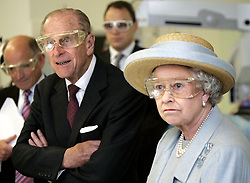 File photo dated 20/10/05 of Queen Elizabeth II and the Duke of Edinburgh wearing safety glasses during a laser surgery demonstration at the University College Hospital, London. The Royal couple will celebrate their platinum wedding anniversary on November 20.