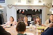 In the Bakers' kitchen, Pickwell Manor, Georgeham, North Devon, UK. From left to right: Liza Baker (9), Millie-grace Elliott (8), Molly Elliott (10), Tracey Elliott.CREDIT: Vanessa Berberian for The Wall Street Journal<br /> HOUSESHARE