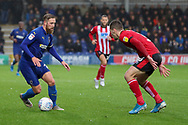 AFC Wimbledon midfielder Scott Wagstaff (7) taking on Lincoln City defender Harry Toffolo (3) during the EFL Sky Bet League 1 match between AFC Wimbledon and Lincoln City at the Cherry Red Records Stadium, Kingston, England on 2 November 2019.