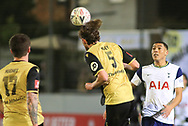 Marine defender Anthony Miley (5) makes a header during the The FA Cup match between Marine and Tottenham Hotspur at Marine Travel Arena, Great Crosby, United Kingdom on 10 January 2021.