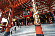 An ornate red-paper lantern over the entrance to the main hall of the Sensoji Buddhist temple in Asakusa, Tokyo, Japan. The temple was built during the Kamakura period in 645 CE and is the oldest and most important temple in Tokyo.