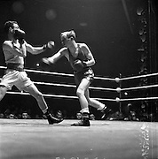 15/03/1963<br /> 03/15/1963<br /> 15 March 1963<br /> National Senior Boxing Championships at the National Stadium, Dublin. J. McCann, St. Georges Boxing club (left) goes up against J. Gaffney of Corinthians.