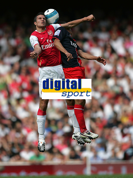 Photo: Lee Earle.<br /> Arsenal v Paris Saint-Germain. The Emirates Cup. 28/07/2007.Arsenal's Robin van Persie clashes with Jeremy Clement.