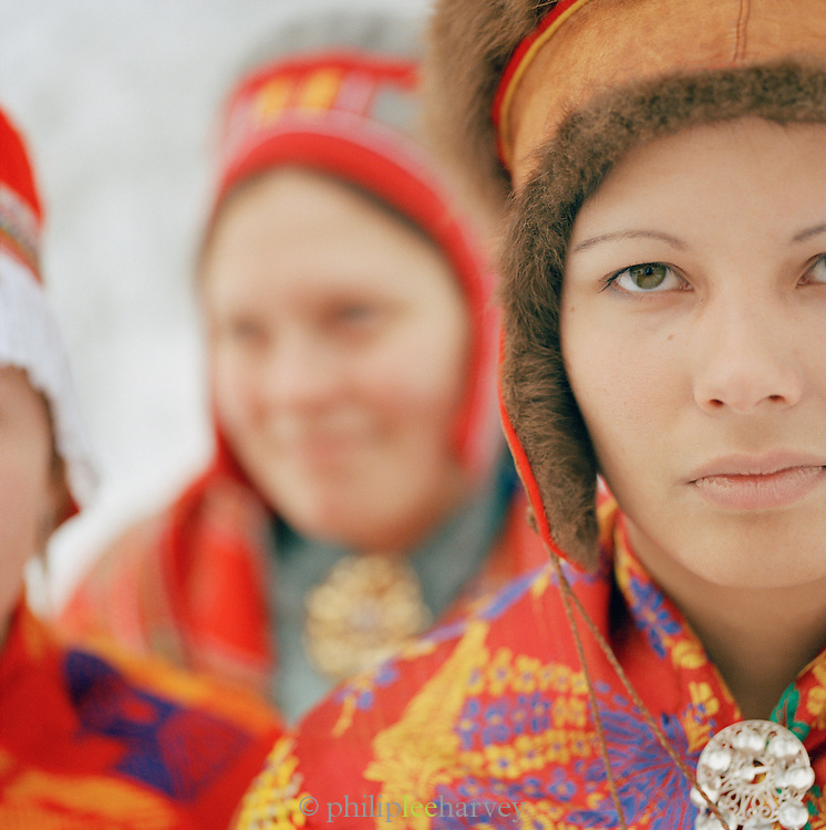 Young Sami women in Gakti, traditional dress, in Lapland, Sweden