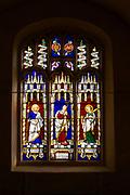 Stained glass east window Bedingfield church, Suffolk, England, UK c1853 prom William Miller three saints John the Baptist, John the Divine, Jacob,
