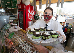 Jenny DeVincenzi shows off some St. Patrick's Day-themed goodies at Genova Delicatessen, voted Best Deli by Bay Area News Group readers in the annual Best in the East Bay poll, Tuesday, March 16, 2021 in Walnut Creek, Calif. (Photo by D. Ross Cameron)