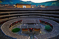 """Chine, Province du Fujian, village de Chuxi, maison forteresse en terre et en bois où logent les membres d'une meme famille de l'ethnie Hakka, inscrit au patrimoine mondial de l'Unesco // China, Fujian province, Chuxi village, Tulou mud house. well known as the Hakka Tulou region, in Fujian. In 2008, UNESCO granted the Tulou """"Apartments"""" World Heritage Status, siting the buildings as exceptional examples of a building tradition and function exemplifying a particular type of communal living and defensive organization. The Fujian Tulou is """"the most extraordinary type of Chinese rural dwellings"""" of the Hakka minority group and other people in the mountainous areas in southwestern Fujian."""