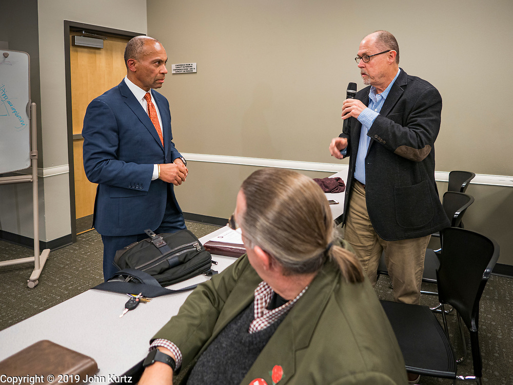 18 NOVEMBER 2019 - DES MOINES, IOWA: Former Governor DEVAL PATRICK (D-MA), left, takes a question from a Polk County Democrat at their November monthly meeting in Des Moines Monday night. Gov. Patrick made his first campaign trip to Iowa Monday after announcing his candidacy to be the Democratic nominee for the US Presidency. His stops included a meeting of the Polk County Democrats in Des Moines. Iowa hosts the first presidential selection event of the 2020 presidential election cycle. The Iowa Caucuses are Feb. 3, 2020.           PHOTO BY JACK KURTZ