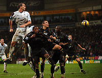 Photo: Paul Greenwood.<br />Bolton Wanderers v Portsmouth. The Barclays Premiership. 30/12/2006. Bolton's Kevin Davies rises above the Pompey defence