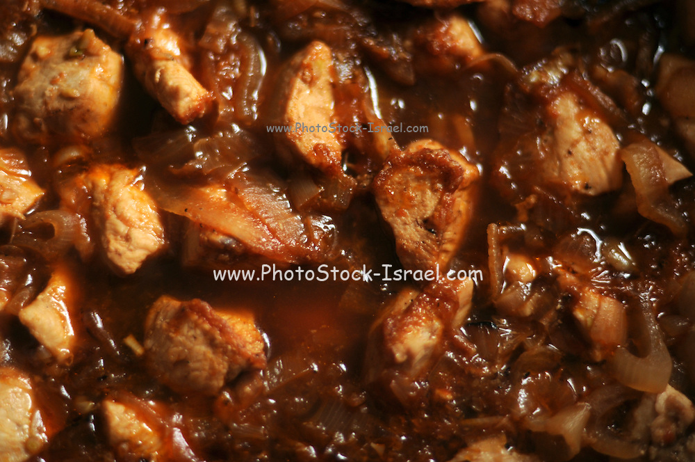slices of Chicken Breast simmering in a pan