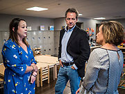 12 SEPTEMBER 2019 - DES MOINES, IOWA: Governor STEVE BULLOCK (D-MT) talks to New Horizons Academy administrators after a Caucus for Kids Facebook Live broadcast sponsored by the Children's Policy Coalition at the school. Gov. Bullock is vying to be the Democratic party's nominee in 2020. He is campaigning in Iowa this week he didn't qualify for the September 12 debate. Iowa traditionally hosts the the first election event of the presidential selection cycle. The Iowa Caucuses will be on Feb. 3, 2020.                 PHOTO BY JACK KURTZ