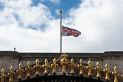 © Licensed to London News Pictures. 09/04/2021. LONDON, UK. The Union flag flies at half mast outside Buckingham Palace after the death of Prince Philip, aged 99, was announced.  Photo credit: Stephen Chung/LNP