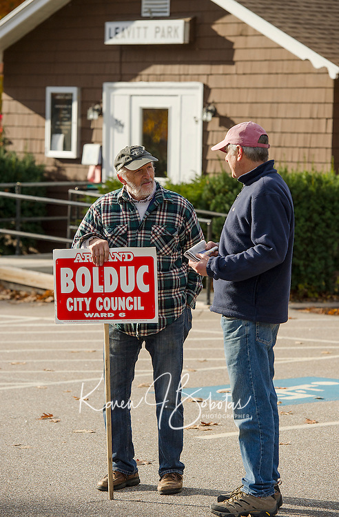 Armand Bolduc Ward 6 City Councilor candidate greets Steve Fay outside Leavitt Park Clubhouse on Election day Tuesday morning.  (Karen Bobotas/for the Laconia Daily Sun)