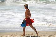 Lifeguard Running Along Beach