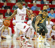 Feb 16, 2013; Fayetteville, AR, USA; Arkansas Razorbacks guard BJ Young (11) keeps control of the ball as Missouri Tigers guard Earnest Ross (33) attempts to steal during a game at Bud Walton Arena. Arkansas defeated Missouri 73-71. Mandatory Credit: Beth Hall-USA TODAY Sports