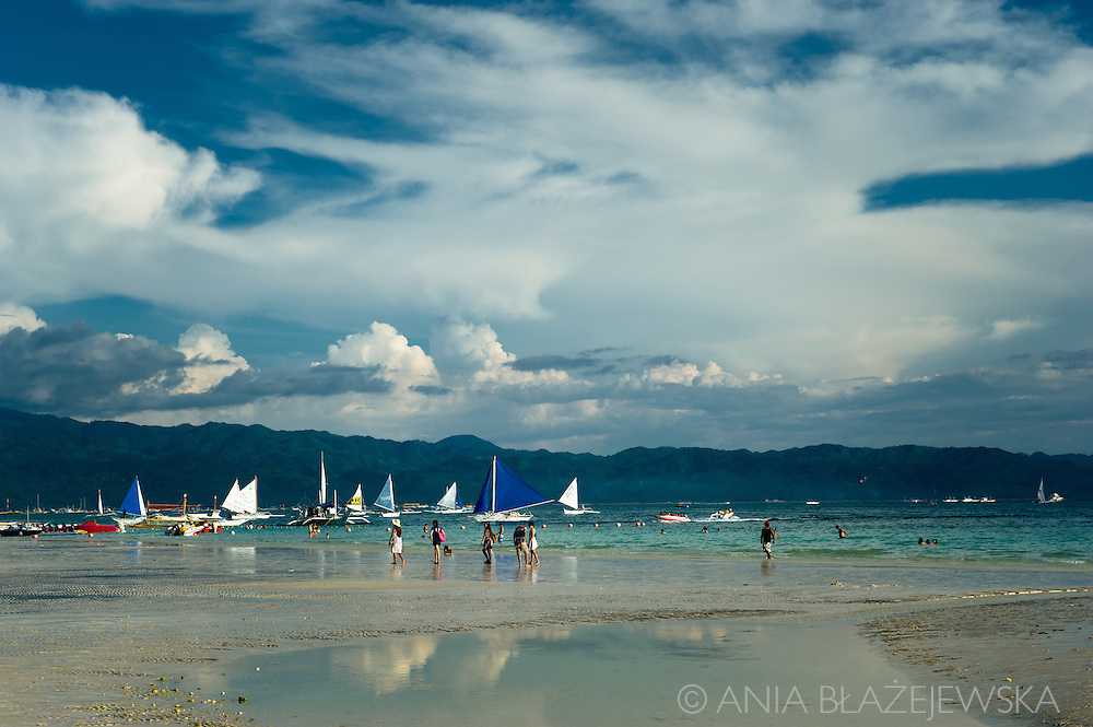 Boracay, a 7 kilometers long tropical island in the Western Visayas is the most popular tourist destination in the Philippines particularly famous for its wonderful white sand beaches which are often voted as one of the most beautiful in the world. Being originally home to Ati tribe, it started its adventure with tourism in late 1970s and now, with over 1 million tourists coming there per year, is a top Filipino holiday destination with luxury hotels, big choice of restaurants serving delicious food and many other activities such as scuba diving, snorkelling, windsurfing and kiteboarding. Two biggest and most known Boracay beaches: 4 km long White Beach attracting people with its powdery white sand and Bulabog Beach, windsurfing and kiteboarding area, are located on opposite sides of the island, but you can easily find there also many smaller beaches making Boracay your real tropical paradise.