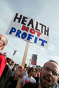 October 9th 2011. Blockade of Westminster Bridge organised by UK Uncut before the NHS bill goes before Parliament on October 12th.A man holds a placard saying 'Health not profit'.11