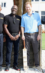 Prince Harry poses with Sir Vivian Richards as he attends a youth sports festival at the Sir Vivian Richards Stadium in North Sound, Antigua, on the second day of his tour of the Caribbean.