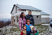 Rudo (25) and his wife Maria (22) with their daughters and son Kevin in front of their new home (01/2016). The family is among those who joined the micro loan program in Rankovce to built themselves their own house with the support of the NGO ETP Slovakia. Self-construction helps to demolish stereotyped views about people from socially excluded communities, whom the majority population regards as abusers of social benefits, socially dependent, incapable, passive and constantly reliant upon state assistance. The approach gives people the opportunity to take care of themselves.