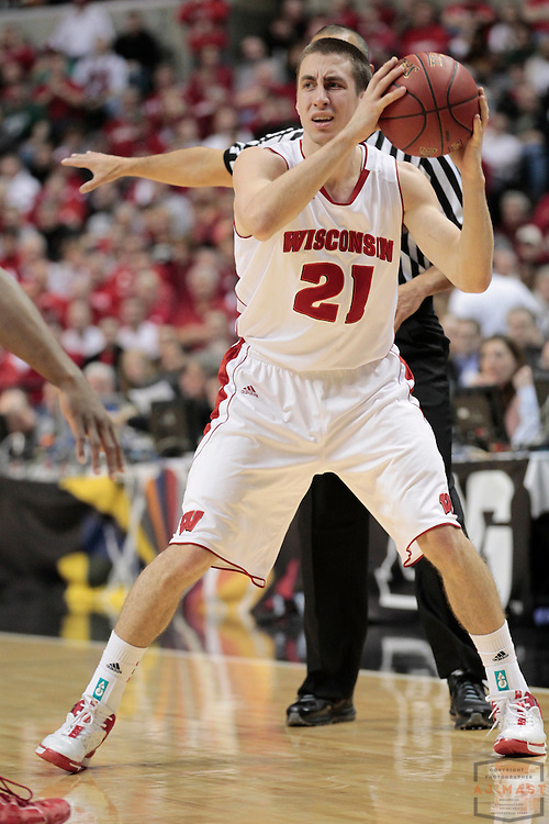 09 March 2012: Wisconsin Badgers guard Josh Gasser (21) as the Indiana Hoosiers played the Wisconsin Badgers in a college basketball game during the Big 10 Men's Basketball Championship in Indianapolis
