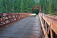 A vehicle crosses the Nisqually River wooden suspension bridge at Longmire village in Mount Rainier National Park, WA USA