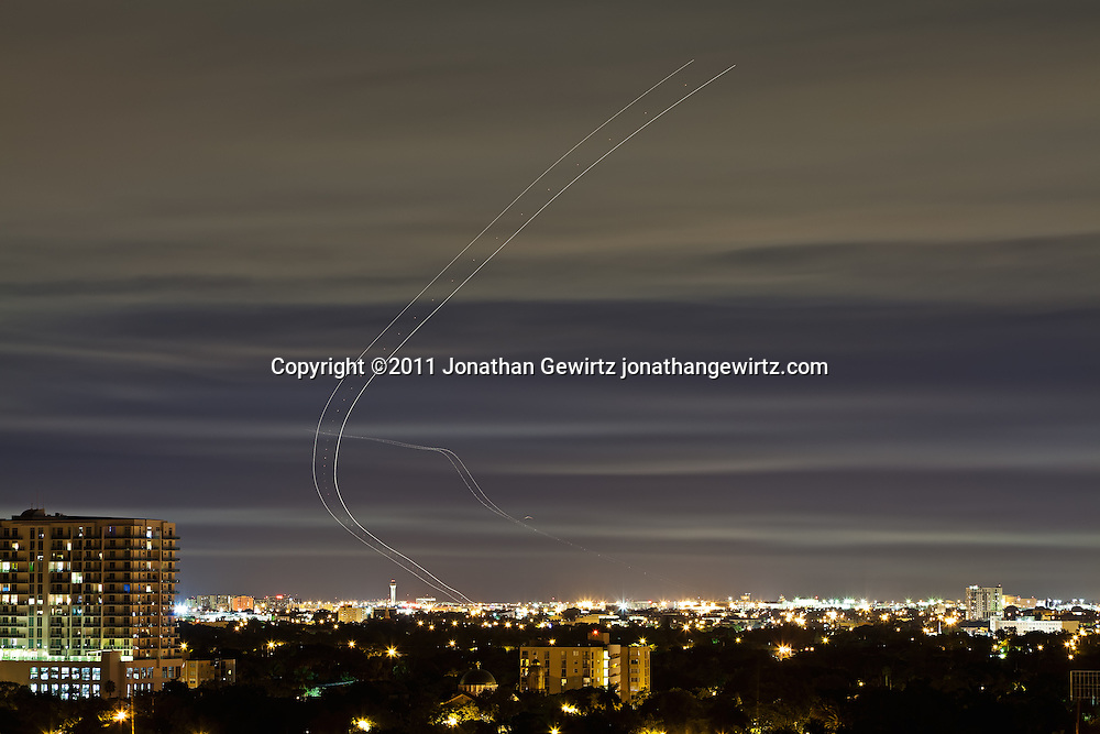 Time exposure of aircraft taking off and landing at Miami International Airport after dark. WATERMARKS WILL NOT APPEAR ON PRINTS OR LICENSED IMAGES.