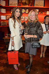 ***UK_MAGAZINES_OUT***<br /> LONDON, ENGLAND 30 NOVEMBER 2016: <br /> Left to right, Mehreen Akbar, Sherry Scott at the launch of In The Spirit of Gstaad at Maison Assouline, Piccadilly, London hosted by Mandolyna Theodoracopulos and Homera Sahni England. 30 November 2016.