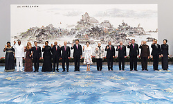September 4, 2017 - Xiamen, Fujian, China - Chinese President Xi Jinping and his wife Peng Liyuan pose for a group photo with leaders attending the 9th BRICS Summit and the Dialogue of Emerging Market and Developing Countries and their spouses before a banquet in Xiamen, southeast China's Fujian Province, Sept. 4, 2017. The photo showed that Guinean President Alpha Conde and his wife, Mexican President Enrique Pena Nieto and his wife, South African President Jacob Zuma and his wife, Russian President Vladimir Putin, Chinese President Xi Jinping and his wife, Egyptian President Abdel-Fattah al-Sisi and his wife, Brazilian President Michel Temer, President of Tajikistan Emomali Rahmon, Indian Prime Minister Narendra Modi, Thai Prime Minister Prayut Chan-o-cha and his wife(from left to right) (Credit Image: © TPG via ZUMA Press)