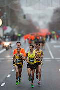 Head of the popular race running down along Serrano street